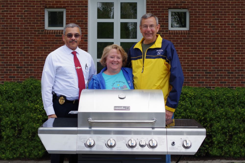 Winners of the Gas Grill Raffle with Lt. Gomes